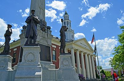 Webster courthouse with statues in front